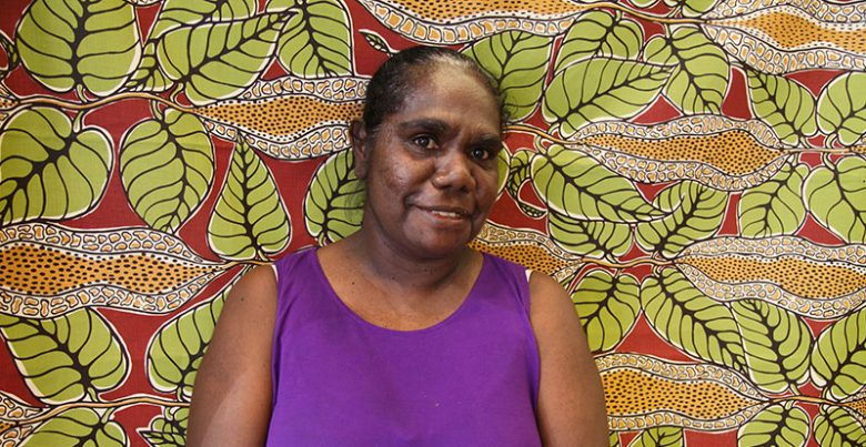 Gracie Kumbi, talented fabric designer and artist works through Merrepen Songlines Aboriginal art gallery Darwin Arts NT